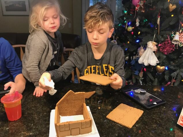 Construction on our Despicable Me 3 gingerbread house continues.