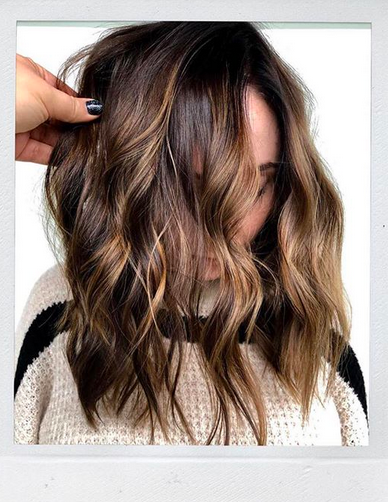 Who doesn't love a good dose of chocolate during the holidays and...all the time? Loving this shiny, chocolate and #bronde balayage, haircut and fabulous lived-in waves by Morganne