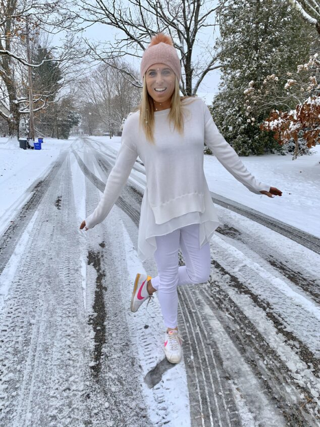 blonde woman wearing white in the winter